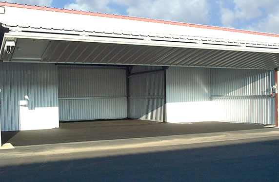 Airplane storage using a Standard T Hangar with Bi-fold Doors