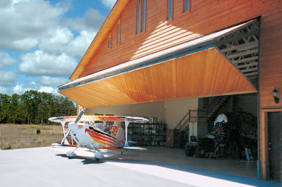 large airplane storage hangar with a Bi-Fold Door